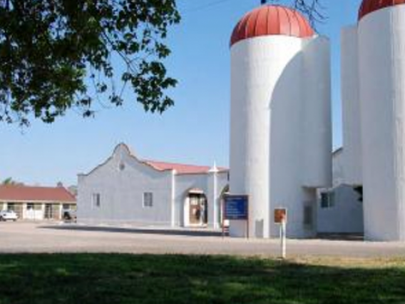 Building and silos at the campus farm